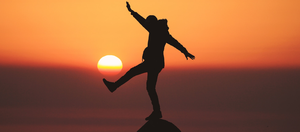 person balancing with sun
