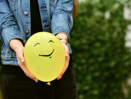 Holding happy balloon