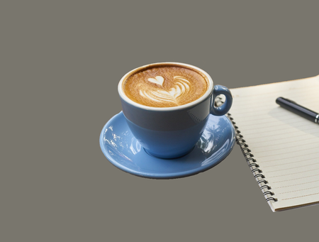 grey box, cup of coffee, notepad
